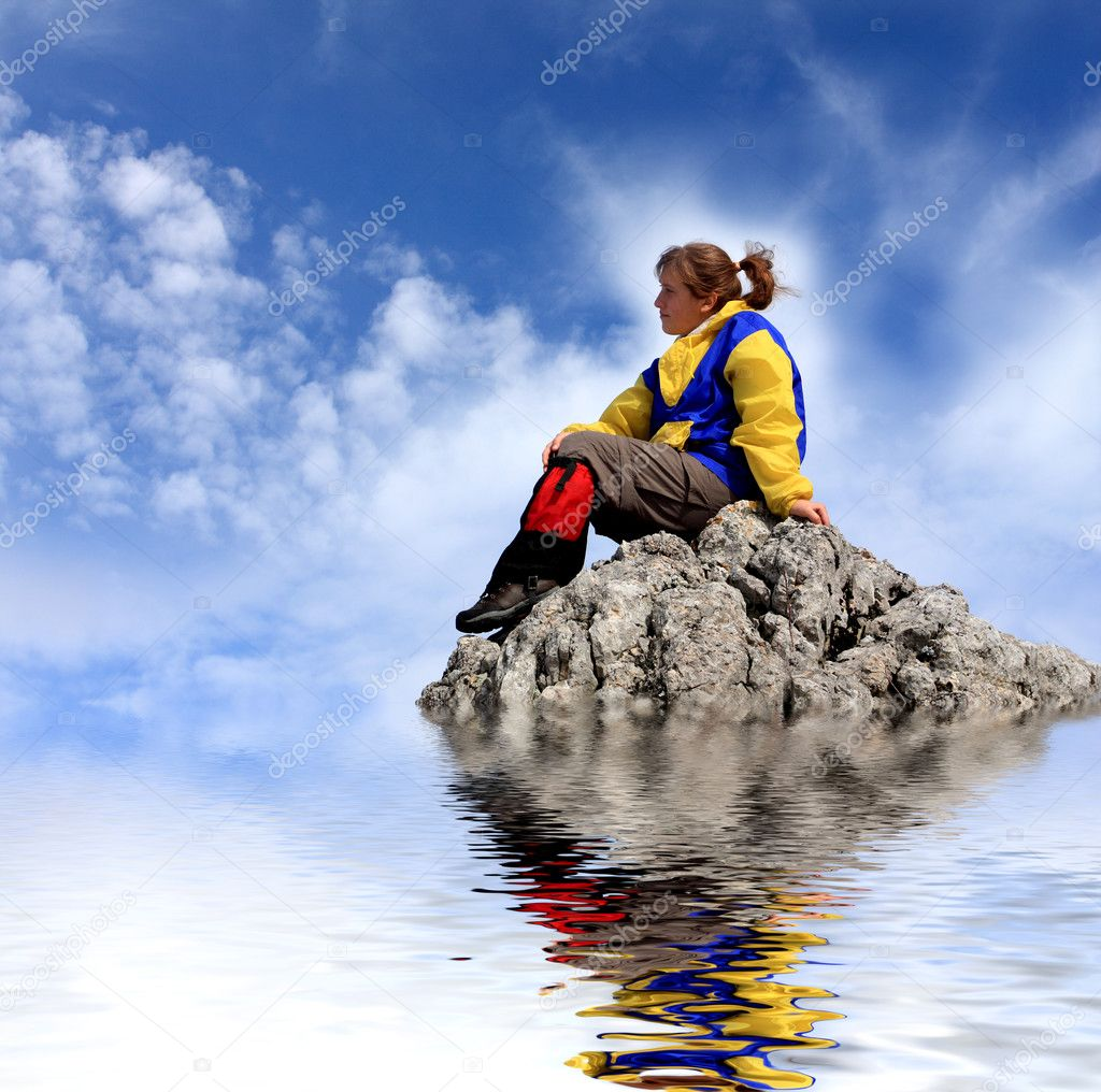 Woman figure on the rock near water — Stock Photo #2621426