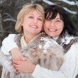 Two happy middle-aged women - Stock Photo