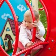 Little girl plays in playground — Stock Photo