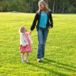Young mother and daughter playing — Stock Photo #2484881