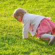 Little girl playing on the grass — Stock Photo