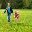 Young mother and daughter playing — Stock Photo #2484965