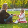 Mother and daughter play in the park — Stock Photo #2484971