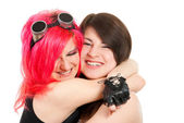 Two girls hugging and laughing. — Stock Photo