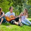 Singing in the park — Stock Photo