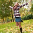 Happy girl on an autumn nature — Stock Photo