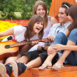 Four young friends play guitar — Stock Photo #2577744