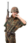 Armed military woman — Stock Photo