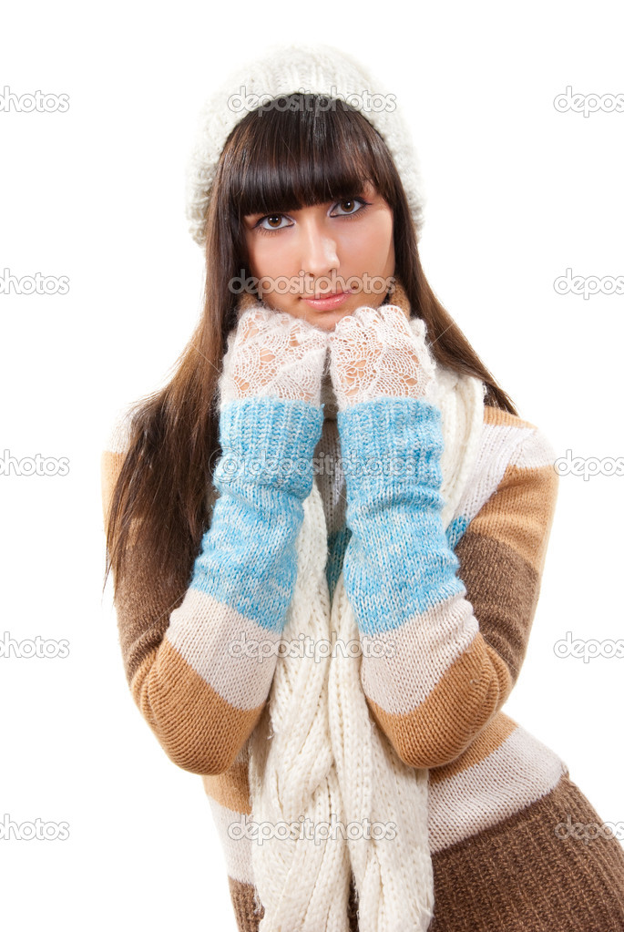 Sexy young woman dressed in a sweater, scarf and cap — Stock Photo #2576101