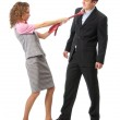 Girl pulls a man in a tie — Stock Photo
