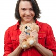 Stock Photo: Young guy with his loved toy