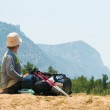 Tired hiker relaxes on a hill — Stock Photo #2607161