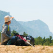 Tired hiker relaxes on a hill — Stock Photo