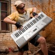 Musician plays a synthesizer — Stock Photo #2607468