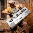 Stock Photo: Musician plays a synthesizer