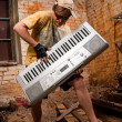 Musician plays a synthesizer — Stock Photo #2607483