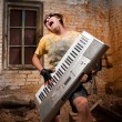 Musician plays a synthesizer — Stock Photo #2607493