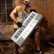 Musician plays a synthesizer — Stock Photo #2607506