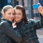 Two happy girls make self-portrait — Stock Photo #2608890