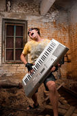Musician plays a synthesizer — Stock Photo