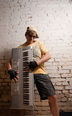 Portrait of musician with synthesizer — Stock Photo