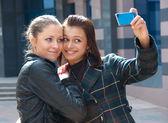 Two happy girls make self-portrait — Stock Photo