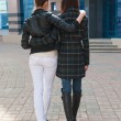 Back view of two embracing girls — Stock Photo
