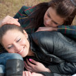 Two girls relax in a park — Stock Photo