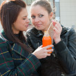 Two girls drink juice — Stock Photo