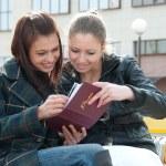 Girls watching photos in album — Stock Photo