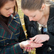 Girls examine lines on a palm — 图库照片
