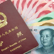 Royalty-Free Stock Photo: Chinese Passport and Chinese Yuan(RMB banknotes)