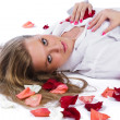 Woman with rose-petal — Stock Photo