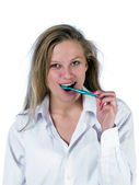 Woman brushing teeth — Stock Photo