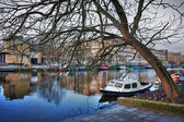Street and the channel with boats — Stock Photo
