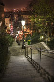 Lamplight, cafes and steep steps — Stock Photo