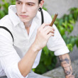 Man thinks while smoking cigar - Stock Photo