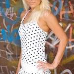 Beautiful blond girl in urban area — Stock Photo #2493862