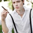 Stock Photo: Man thinks while smoking cigar