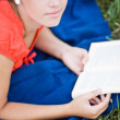 Young girl relaxing and reading a book — Stock Photo