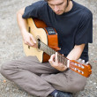 Rough country guy playing his guitar — Stock Photo