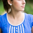 Portrait of young girl in blue top — Stock Photo