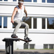 Skate making a slide with his skateboard — Stock Photo
