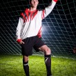 Soccer player in the dark — Stock Photo