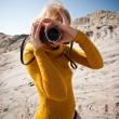 Royalty-Free Stock Photo: Woman with a camera taking photos
