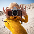 Woman with a camera taking photos — Stock Photo