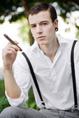 Man thinks while smoking cigar — Stock Photo