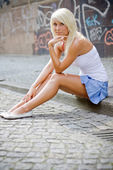 Beautiful blond girl in urban area — Stock Photo