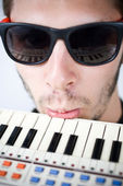 Cool guy frustrated on keyboard — Stock Photo