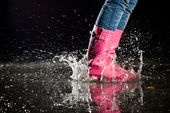 Thrill of a puddle jump — Stock Photo